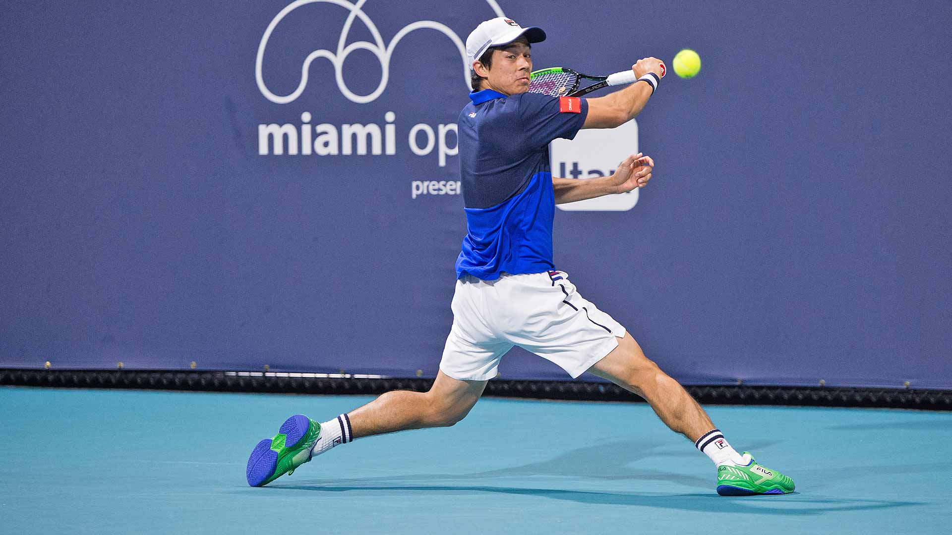 Mackenzie McDonald plays a backhand at the Miami Open.