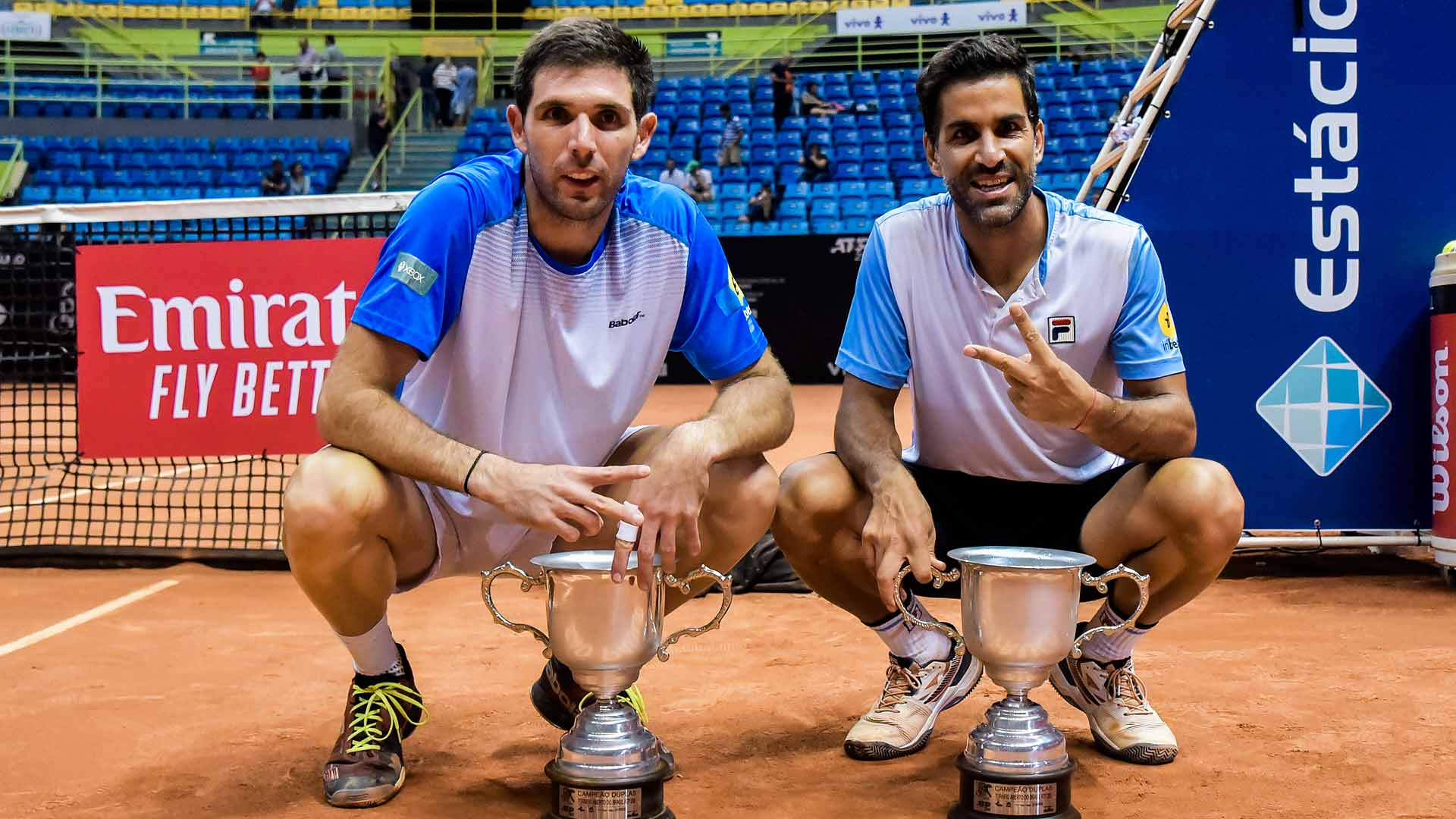 Federico Delbonis and Maximo Gonzalez hold their Brasil Open trophies.