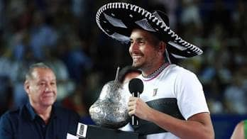 Nick Kyrgios holds his winner's trophy in Acapulco