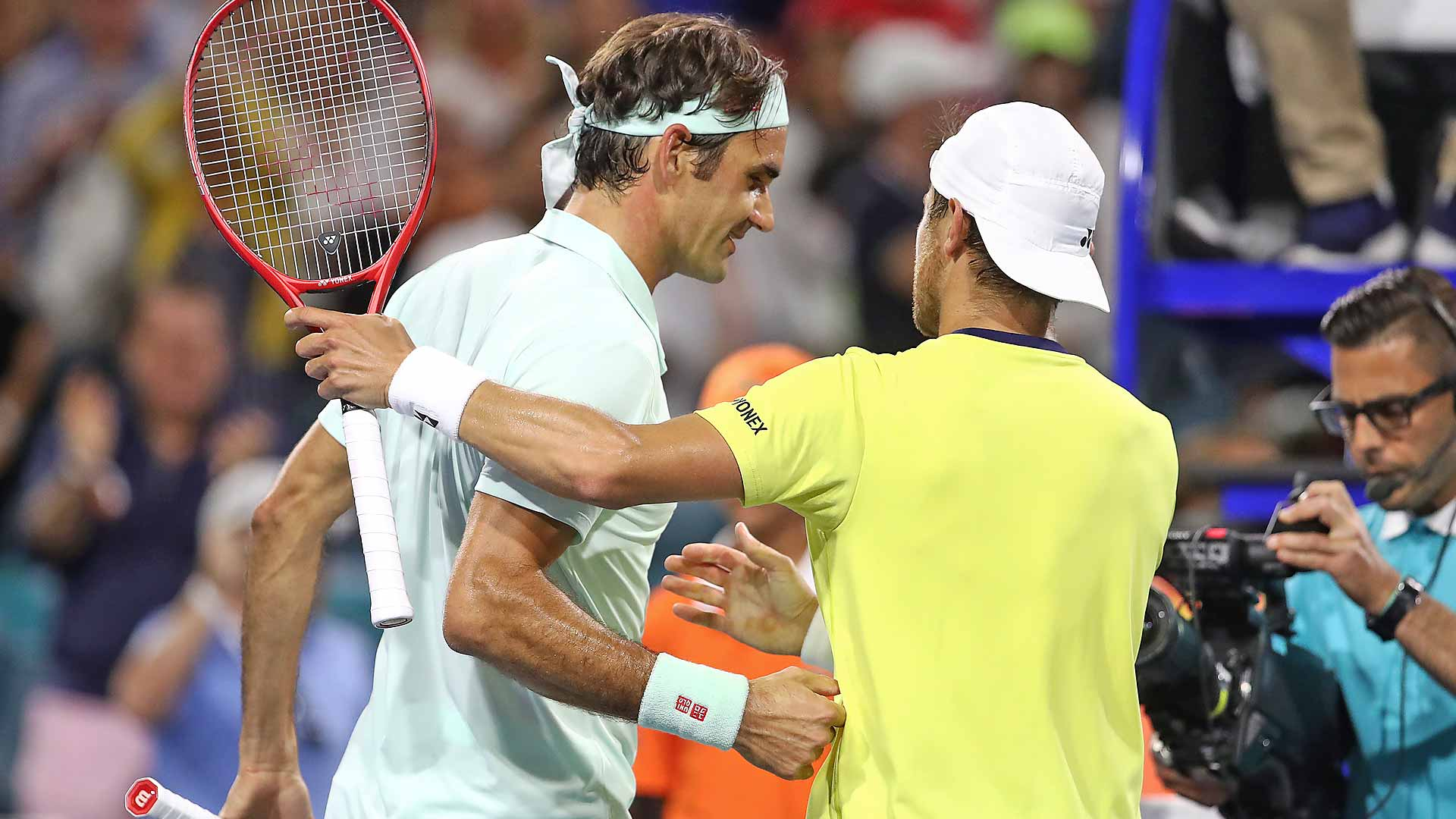 Roger Federer shakes hands with Radu Albot after their match in Miami