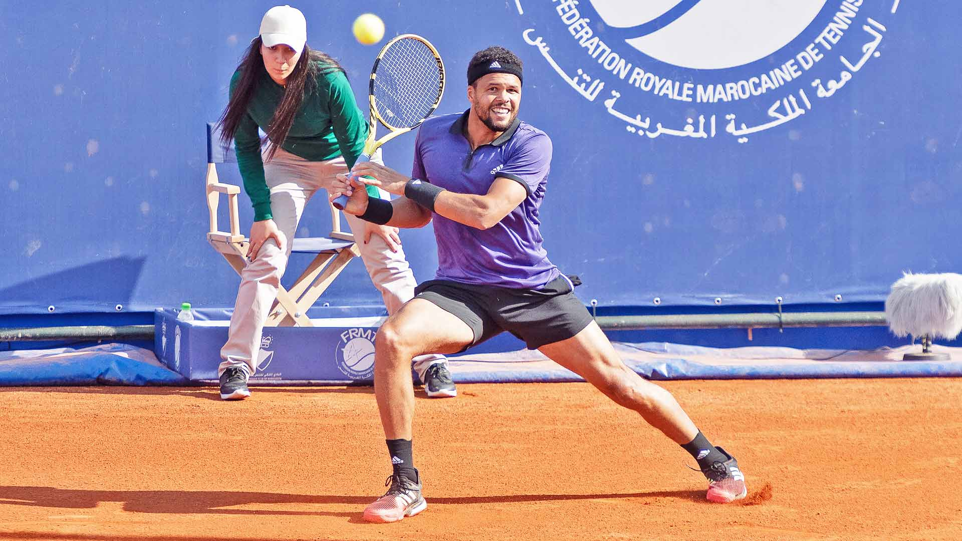 Jo-Wilfried Tsonga hits a backhand during his opener in Marrakech