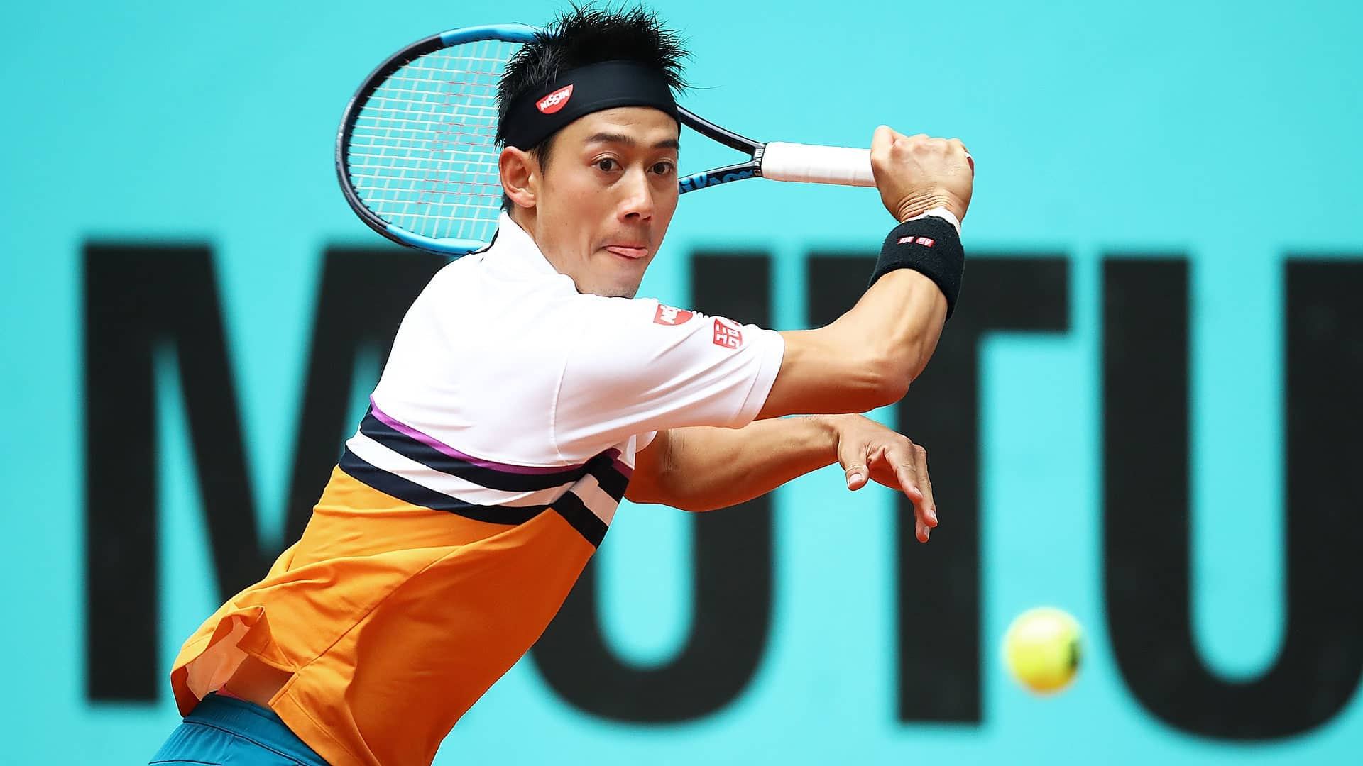 Nishikori hits a backhand on Thursday in Madrid.