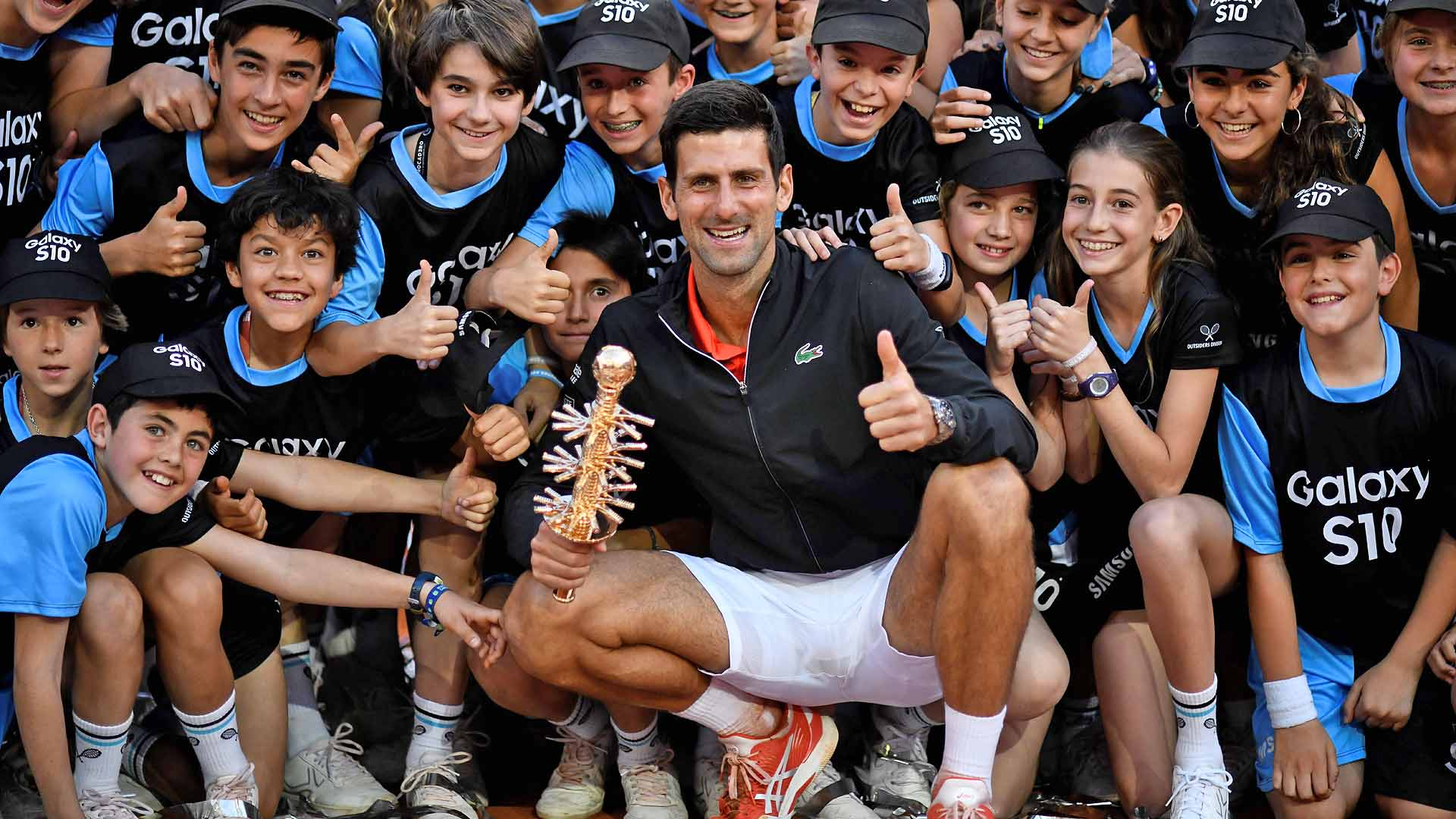Novak Djokovic celebrates his Madrid title