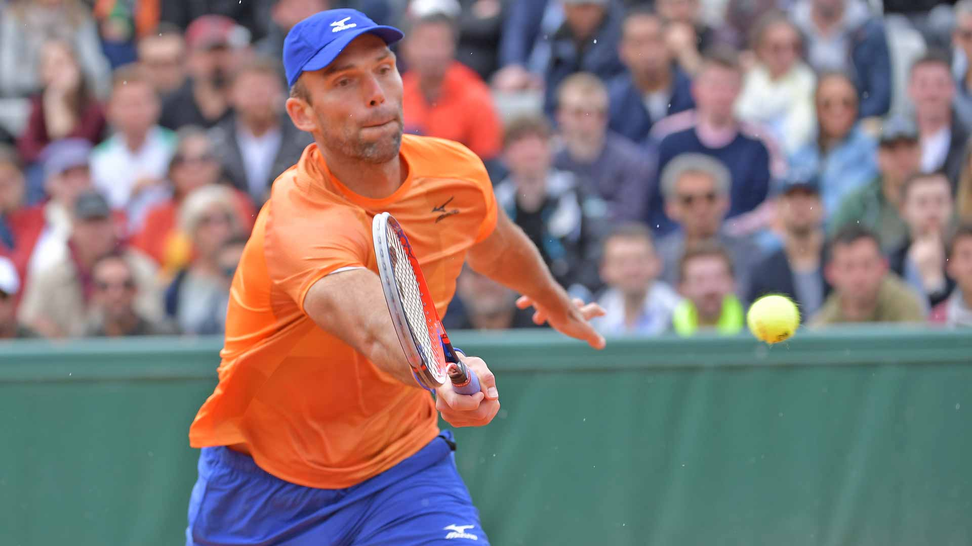 Ivo Karlovic hits a volley at Roland Garros