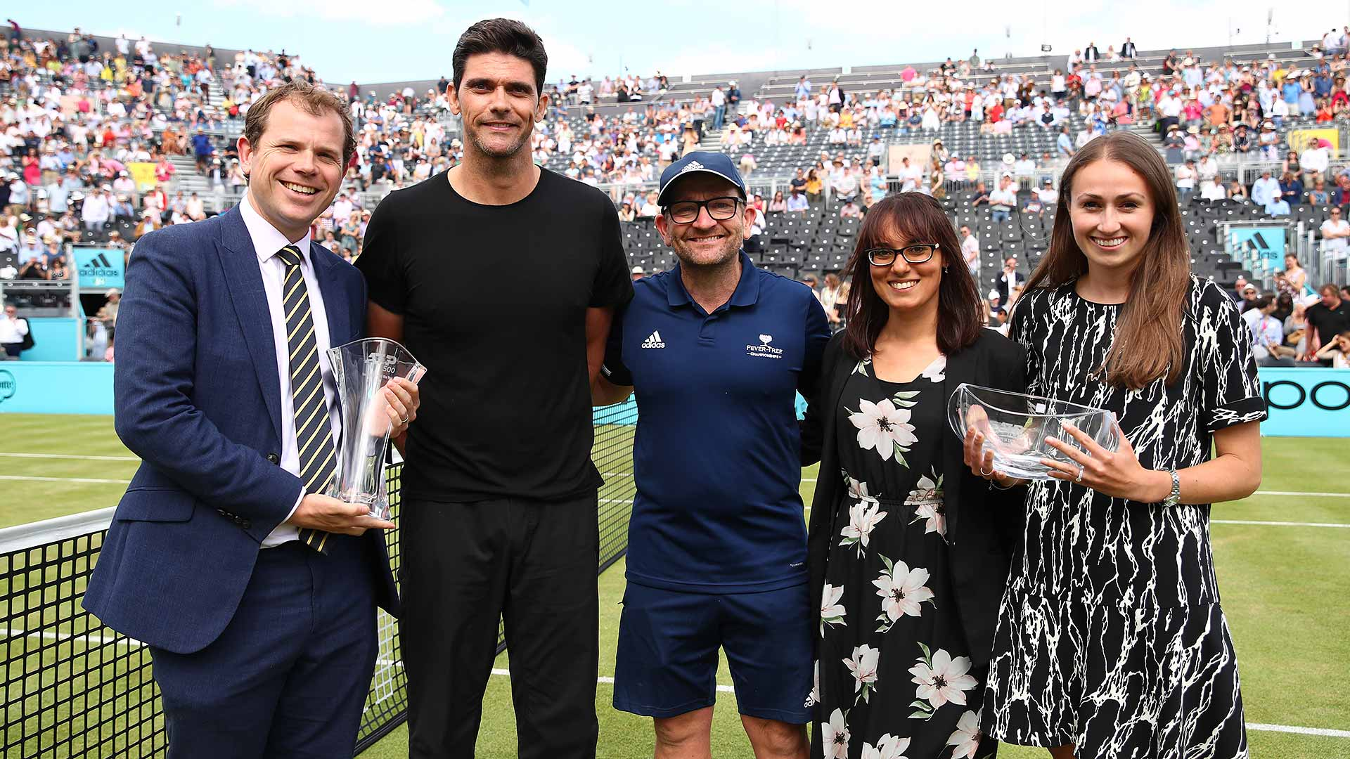 Tournament Director Stephen Farrow receives a trophy from Mark Philippoussis, recognising the Fever-Tree Championships as the ATP 500 Tournament of the Year in the 2018 ATP Awards.