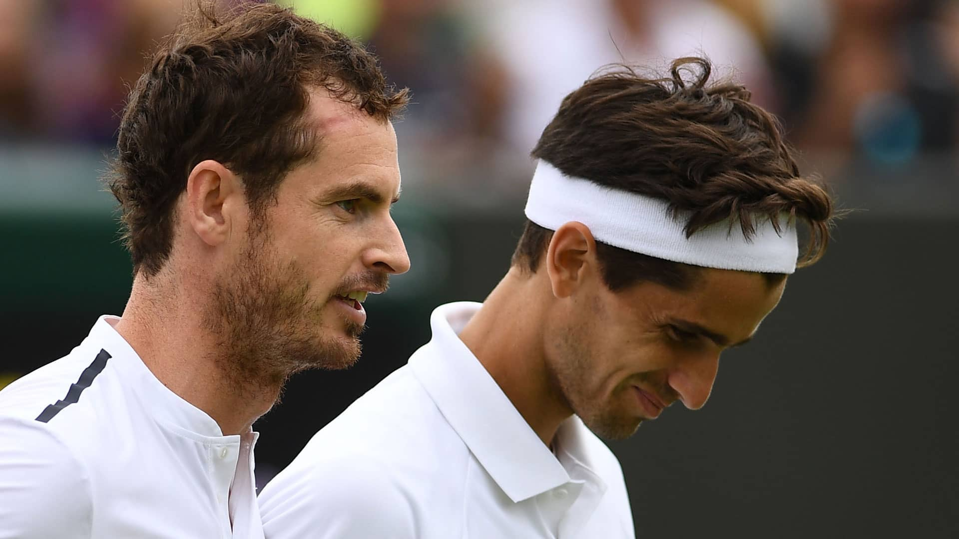 Andy Murray and Pierre-Hugues Herbert in second-round action at Wimbledon 2019
