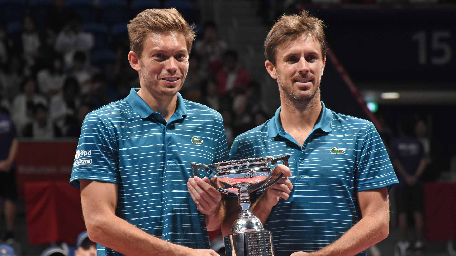 Nicolas Mahut and Edouard Roger-Vasselin hold the trophy in Tokyo 2019