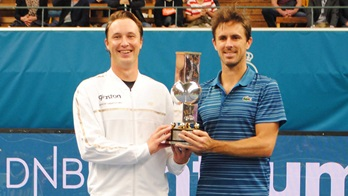 Henri Kontinen and Edouard Roger-Vasselin lift their debut team title at the Intrum Stockholm Open.