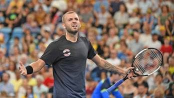 Dan Evans toils for more than three hours to defeat Alex de Minaur and level the Great Britain-Australia ATP Cup Final Eight tie.