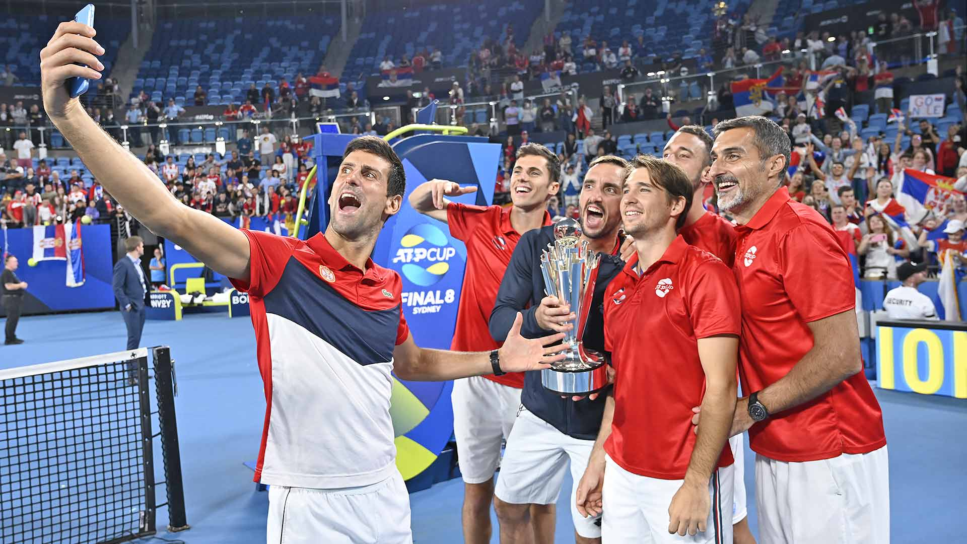 Team Serbia celebrates after beating Team Spain 2-1 to win the ATP Cup.