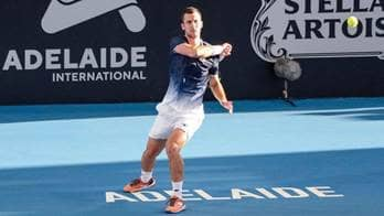 Laslo Djere beats Alexei Popyrin in three sets at the Adelaide International on Sunday.